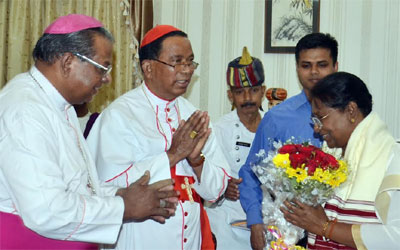 Governor Droupadi Murmu receives bouquet from Cardinal Telespher P Toppo