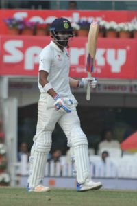 India's Lokesh Rahul celebrates his half Century on the 2nd day of third test match against Australia