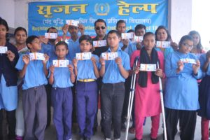 Mentally Challenge students of 'Srijan' showing test match tickets of India VS Australia