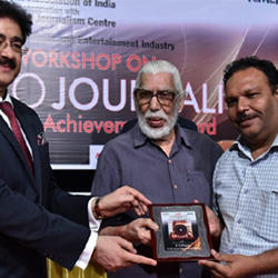 Photojournalist S.S. Dogra honored with National Achievement Award