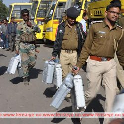 Police officials carry EVMs before leaving for 3rd phase of Jharkhand assembly Election